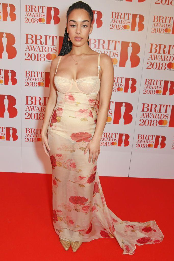 <p>2019's Critics' choice award winner Jorja Smith made her debut at the BRITs in a floral, sheer Dolce & Gabbana gown.</p>