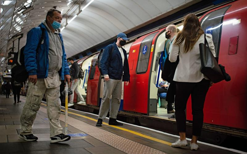 Commuters on a Northern line at 07:46 in central London, after Prime Minister Boris Johnson announced a range of new restrictions to combat the rise in coronavirus cases in England. PA Photo.  - Aaron Chown/PA