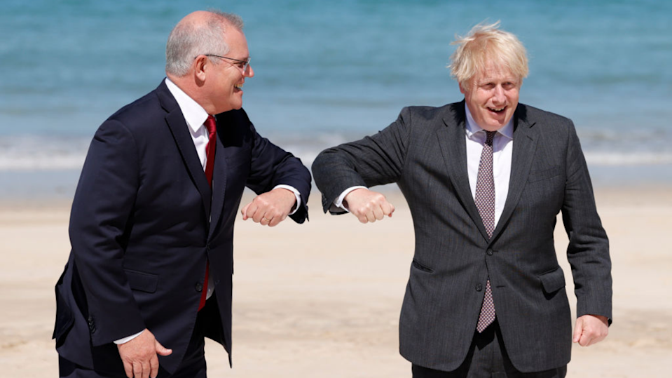 Prime Ministers Scott Morrison and Boris Johnson will release further details of the deal later on Tuesday. (Image: Getty).