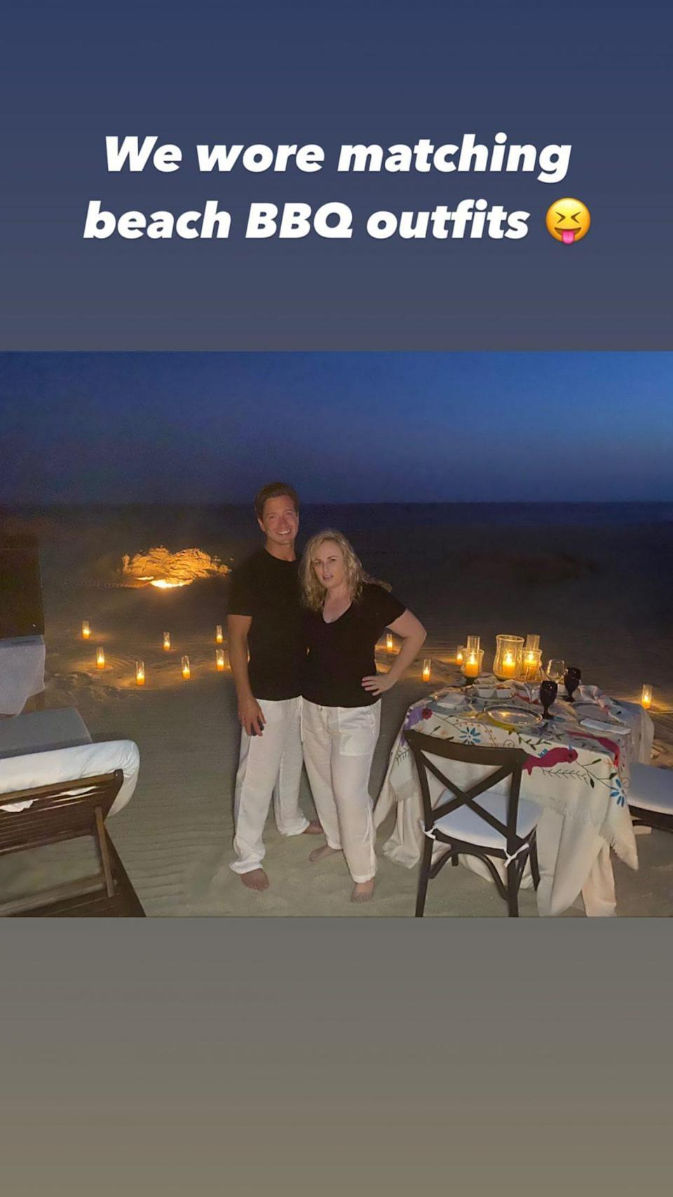 """<p>Despite the travel restrictions due to the ongoing pandemic, Wilson has traveled a fair amount — spending time in New York City, L.A. and Australia, in addition to taking trips with Busch to Cabo San Lucas and Aspen. </p> <p>During their time in Mexico, the pair enjoyed <a href=""""https://people.com/movies/rebel-wilson-boyfriend-jacob-busch-have-romantic-bbq-date-night-mexico/"""" rel=""""nofollow noopener"""" target=""""_blank"""" data-ylk=""""slk:a romantic beachside movie night"""" class=""""link rapid-noclick-resp"""">a romantic beachside movie night</a>, surrounded by candles and snacking on BBQ food. </p>"""