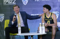 Oregon head coach Dana Altman, left, speaks next to Will Richardson during Pac-12 Conference NCAA college basketball media day Wednesday, Oct. 13, 2021, in San Francisco. (AP Photo/Jeff Chiu)