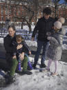 New York State Senator Brad Hoylman, left, with his husband David Sigal, right, with their daughters Lucy Hoylman-Sigal, 3, left, and Silvia Hoylman-Sigal, 10, both born through surrogacy, Saturday Feb. 6, 2021, in New York. Sen. Hoylman is the lead sponsor of a New York State law taking effect on Feb. 15 that legalizes commercial surrogacy. (AP Photo/Bebeto Matthews)