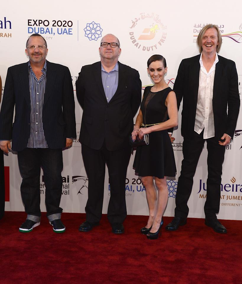 """DUBAI, UNITED ARAB EMIRATES - DECEMBER 11:  Producer Aron Warner, Jacques Methe, actress Erica Linz and director Andrew Adamson attend the """"Cirque du Soleil: Worlds Away 3D"""" premiere during day three of the 9th Annual Dubai International Film Festival held at the Madinat Jumeriah Complex on December 11, 2012 in Dubai, United Arab Emirates.  (Photo by Andrew H. Walker/Getty Images for DIFF)"""