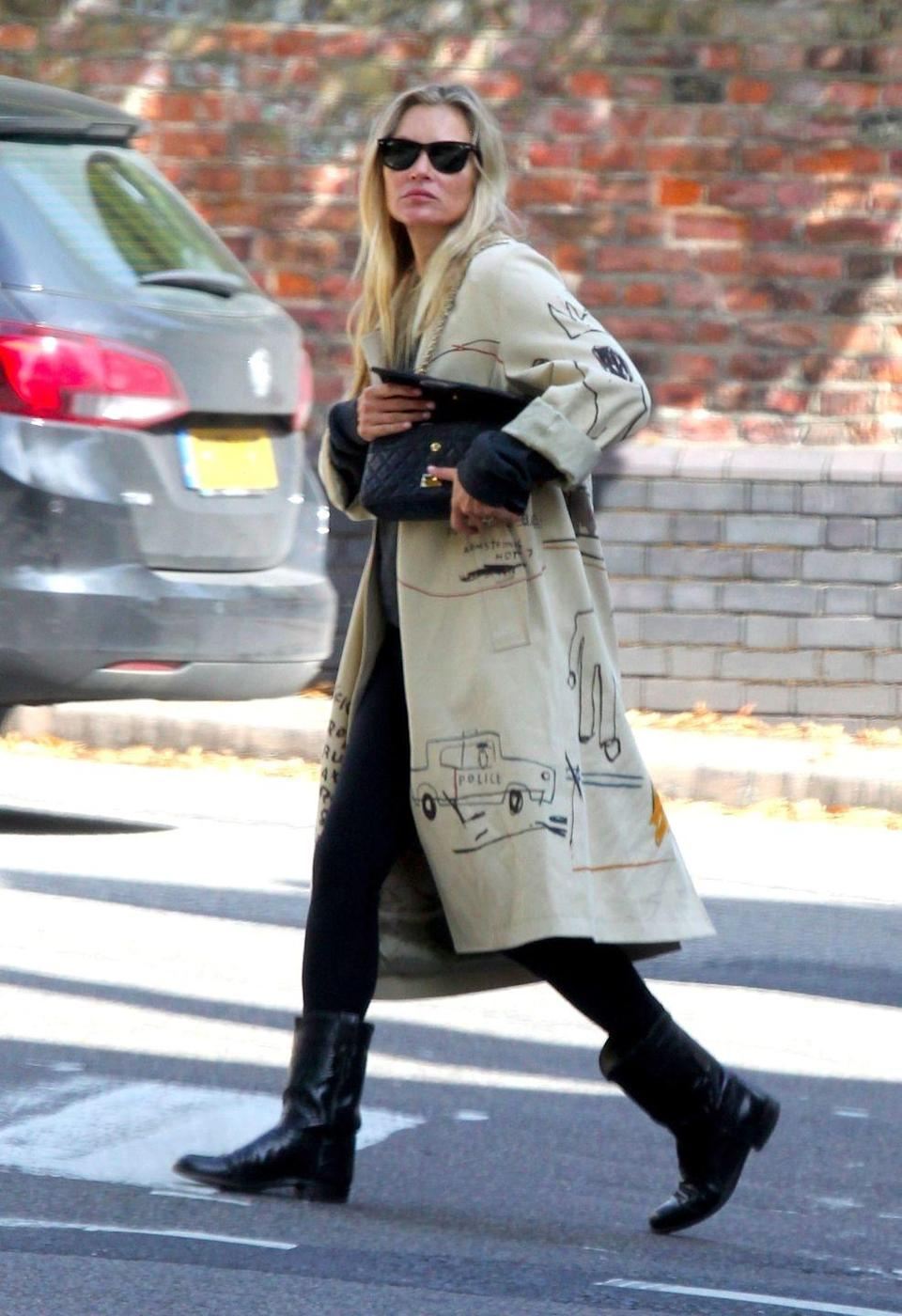 <p><strong>10 September </strong>Kate Moss was seen wearing a Coach x Jean-Michel Basquiat trench coat out in London. </p>