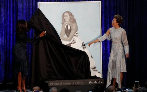 Artist Amy Sherald (R) and former first lady Michelle Obama participate in the unveiling of Mrs. Obama's portrait at the Smithsonian's National Portrait Gallery in Washington - Credit: Reuters
