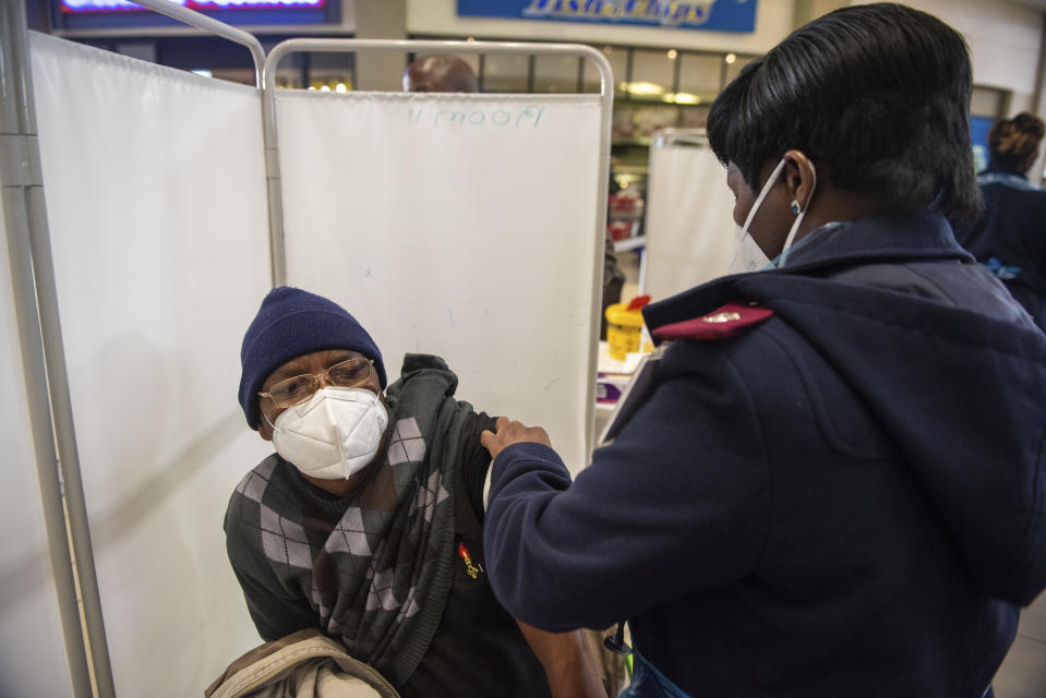 A patient is vaccinated against COVID-19 in Hammanskraal, South Africa, Tuesday, July 6, 2021. New vaccination centres are being opened as South Africa's resurgence of COVID-19 is setting record numbers of new daily cases driven by the delta variant that was first found in India. (AP Photo/Alet Pretorius)