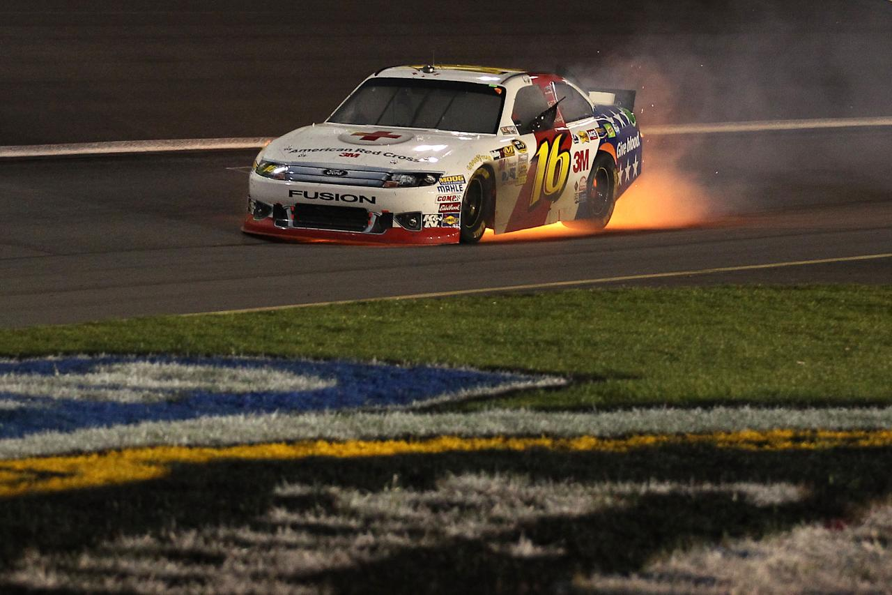 CHARLOTTE, NC - MAY 19:  Greg Biffle blows the engine of the #16 3M/American Red Cross Ford during the NASCAR Sprint All-Star Race at Charlotte Motor Speedway on May 19, 2012 in Charlotte, North Carolina.  (Photo by Scott Halleran/Getty Images for NASCAR)