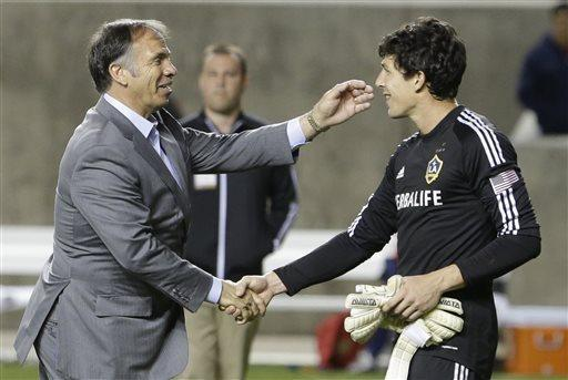Los Angeles Galaxy head coach Bruce Arena reaches for his goalie Brian Rowe, right following their MLS soccer game against Real Salt Lake Saturday, April 27, 2013, Sandy, Utah. The Galaxy defeated Real Salt Lake 2-0. (AP Photo/Rick Bowmer)