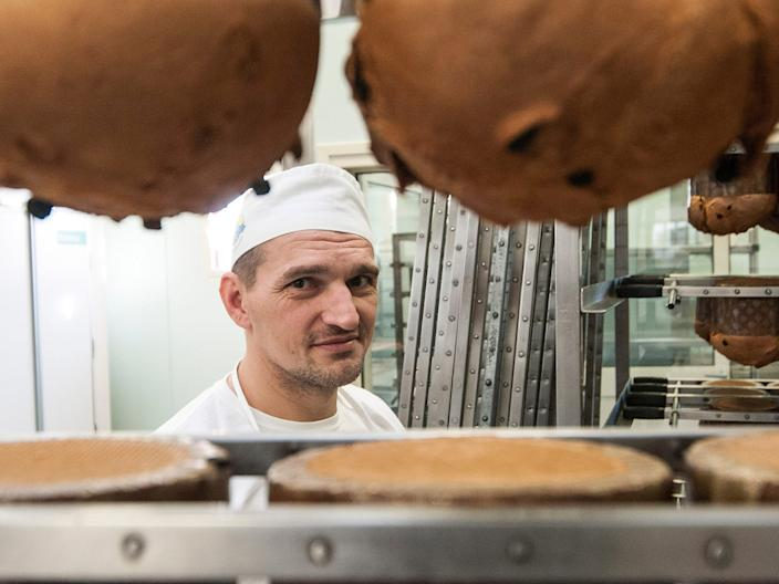 PADOVA, VENETO - NOVEMBER 27: A prisoner looks on in the bakery on November 27, 2015 in Padova, Italy. Inmates working for the Giotto Cooperative as bakers produce traditional panettone Christmas cake at the state maximum security jail Due Palazzi in Padova. (Photo by Awakening/Getty Images)