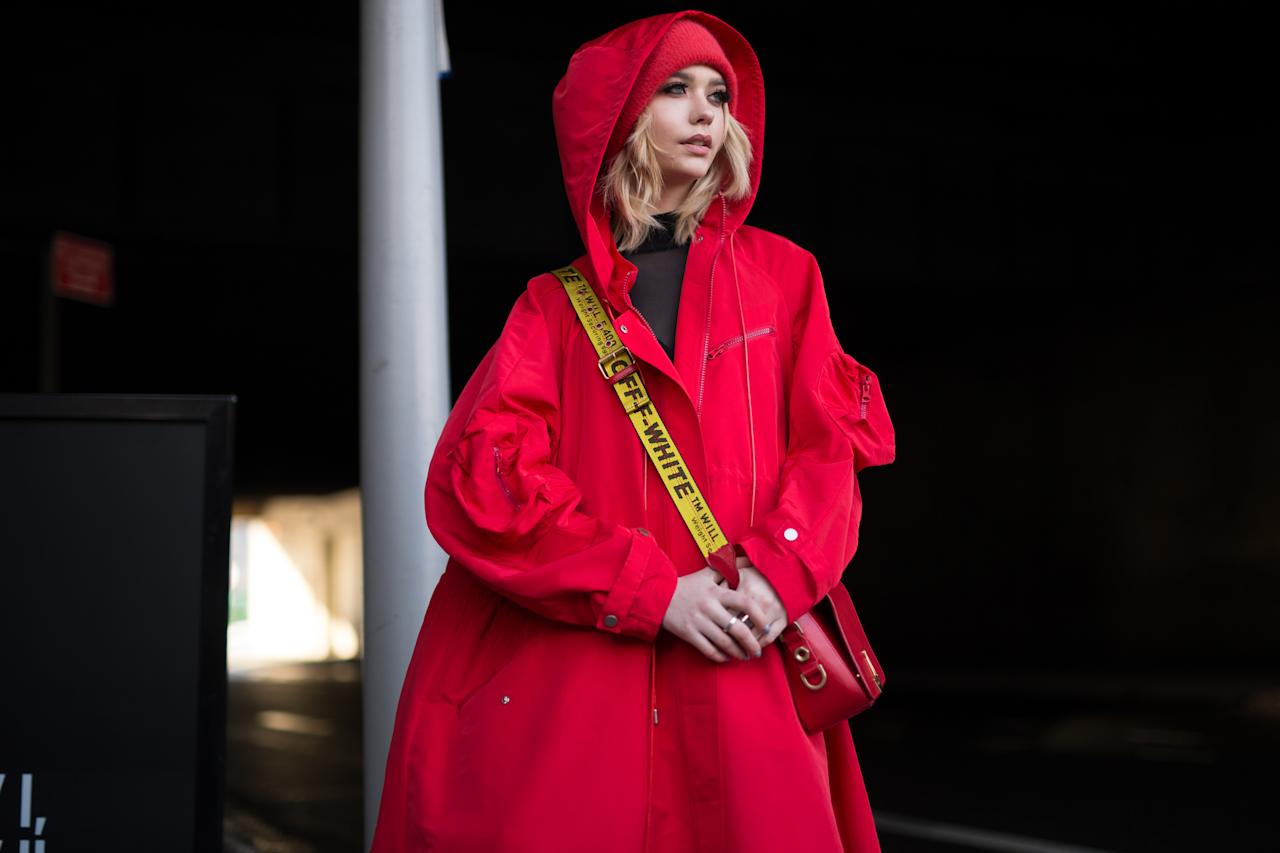 <p>One of the easiest style tips for dressing in the cold is to stay monochromatic. Match your hat with your coat, bag, pants, and shoes. To make it more interesting, forget black, and dress in a bright color like crimson (seen here), cobalt blue, or forest green. (Photo: Getty) </p>