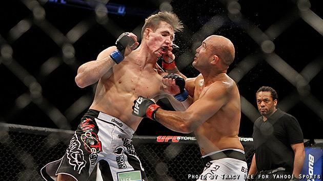 Rory MacDonald lands a punch on BJ Penn during their fight at UFC on Fox 5. (Credit: Tracy Lee for Yahoo! Sports)