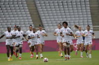 United States players jog out onto the pitch at the start of their women's rugby sevens 5-8 placing match against China at the 2020 Summer Olympics, Saturday, July 31, 2021 in Tokyo, Japan. (AP Photo/Shuji Kajiyama)