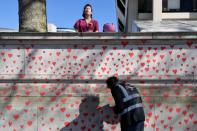 Wall of hearts wall is seen painted as a memorial to all those who have died so far in the UK from COVID-19, amid the spread of the coronavirus disease pandemic in London