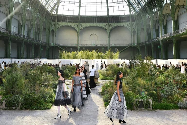 The clothes were the star: Chanel's haute couture Paris show was set around an overgrown garden in a convent cloister (AFP Photo/Christophe ARCHAMBAULT)