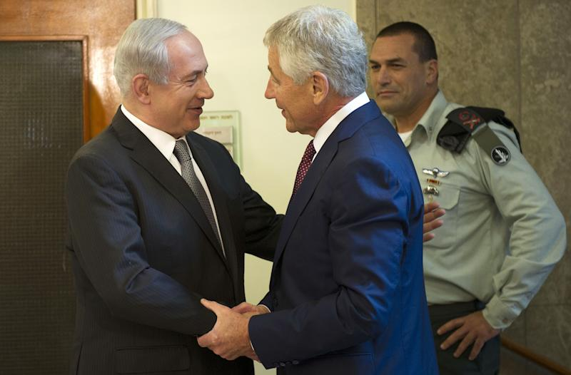 """Israeli Prime Minister Benjamin Netanyahu, left, welcomes U.S. Secretary of Defense Chuck Hagel at his office in Jerusalem, on Tuesday, April 23, 2013. Hagel said the U.S. and Israel need to ensure that their alliance is """"closer than ever,"""" as Mideast security challenges grow more complicated.  (AP Photo/Jim Watson, Pool)"""