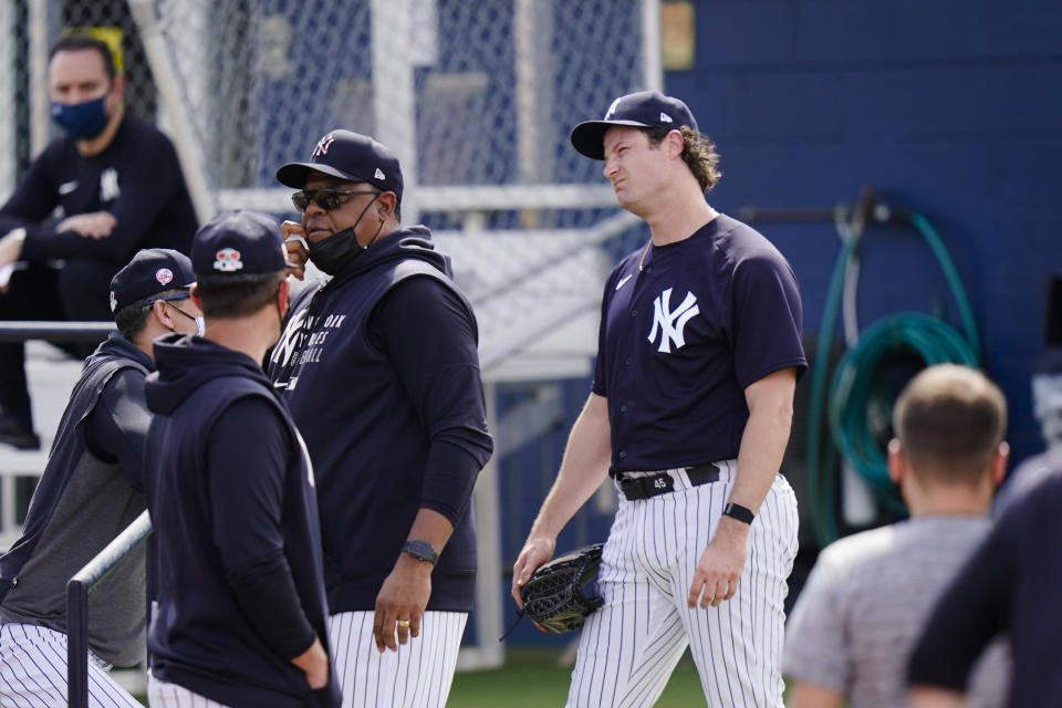 New York Yankees' Gerrit Cole, right, reacts after a spring training baseball workout Monday, Feb. 22, 2021, in Tampa, Fla. (AP Photo/Frank Franklin II)
