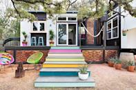 """<p>The owner of this Austin abode turned two mobile trailers into one 400-square-foot home that's connected only by a deck.</p><p><a class=""""link rapid-noclick-resp"""" href=""""https://www.countryliving.com/home-design/house-tours/g3052/austins-colorful-400-square-foot-home"""" rel=""""nofollow noopener"""" target=""""_blank"""" data-ylk=""""slk:SEE INSIDE"""">SEE INSIDE</a></p>"""