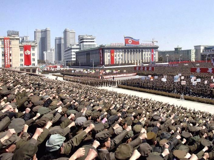 north korea rally soldiers march