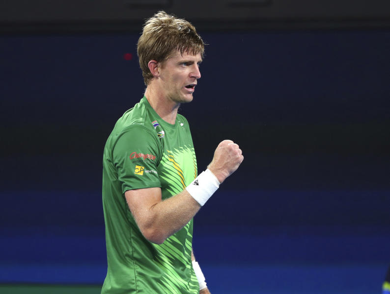 Kevin Anderson of South Africa reacts after winning a point during his match against Novak Djokovic of Serbia at the ATP Cup tennis tournament in Brisbane, Australia, Saturday, Jan. 4, 2020. (AP Photo/Tertius Pickard)