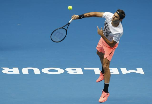 Tennis - Australian Open - Melbourne, Australia, January 13, 2018. Roger Federer of Switzerland serves during a practice session ahead of the Australian Open tennis tournament. REUTERS/Thomas Peter