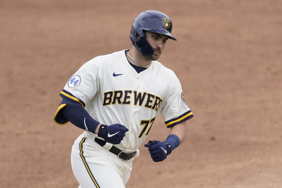 Milwaukee Brewers' Garrett Mitchell (77) runs the bases after hitting a home run during the third inning of a spring training baseball game against the Texas Rangers Saturday, March 13, 2021, in Phoenix. (AP Photo/Ashley Landis)
