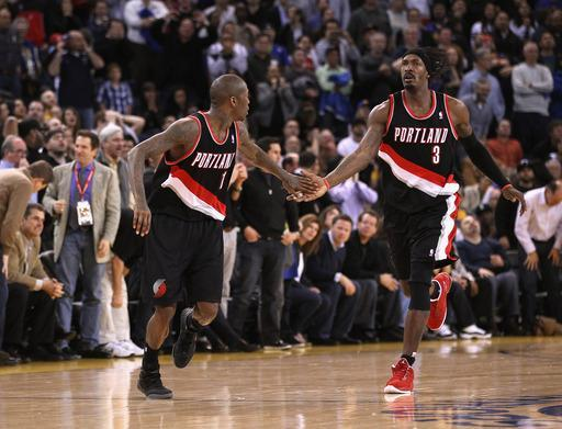OAKLAND, CA - FEBRUARY 15: Jamal Crawford #11 is congratulated by Gerald Wallace #3 of the Portland Trail Blazers after making a basket during their game against the Golden State Warriors at Oracle Arena on February 15, 2012 in Oakland, California. (Photo by Ezra Shaw/Getty Images)