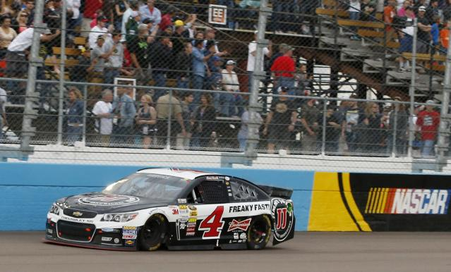 Kevin Harvick comes in to the finish line to win the NASCAR Sprint Cup Series auto race Sunday, March 2, 2014, in Avondale, Ariz. (AP Photo/Ross D. Franklin)