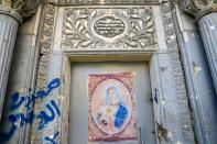 A picture of the Virgin Mary is seen on the door of a church in the old city of Mosul