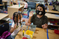 Teacher Juliana Urtubey, right, works with A'Real Wilkerson-Lay in a class at Kermit R Booker Sr Elementary School Wednesday, May 5, 2021, in Las Vegas. Urtubey is the the 2021 National Teacher of the Year. (AP Photo/John Locher)