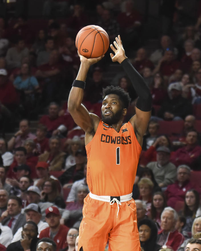 Oklahoma St forward Jonathan Laurent (1) shoots the ball during the first half of an NCAA college basketball game against Oklahoma in Norman, Okla., Saturday, Feb. 1, 2020. (AP Photo/Kyle Phillips)