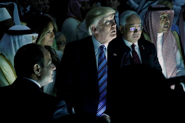 <p>U.S. President Donald Trump and first lady Melania Trump watch a wall of computer screens come online as they tour the Global Center for Combatting Extremist Ideology in Riyadh, Saudi Arabia, May 21, 2017. (Photo: Jonathan Ernst/Reuters) </p>