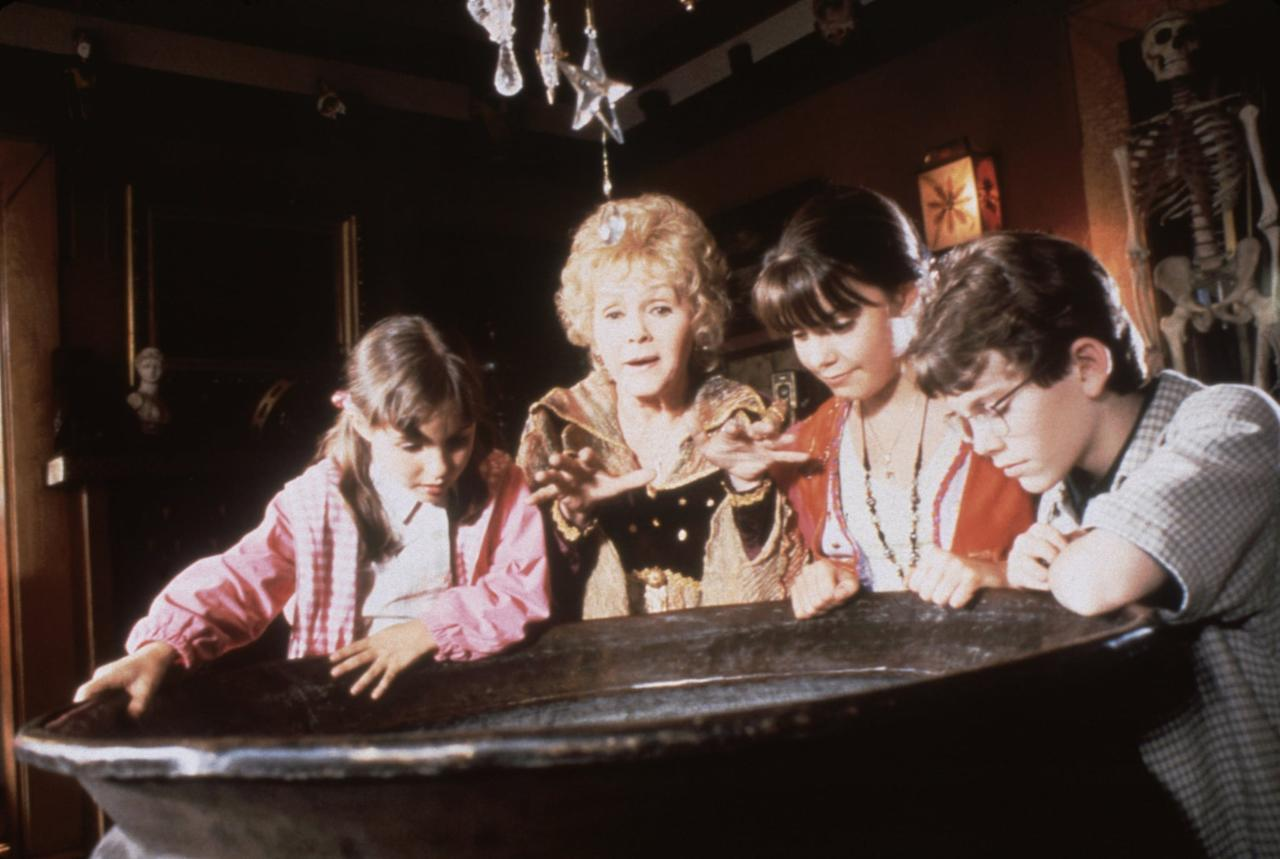 """<p>A teenage girl learns that she comes from a family of witches in <strong>Halloweentown</strong>. Her eccentric grandmother, played by the one and only Debbie Reynolds, asks for help when people from her hometown start disappearing.</p> <p>Watch <strong>Halloweentown</strong> on <a href=""""https://www.popsugar.com/buy?url=https%3A%2F%2Fwww.amazon.com%2Fdp%2FB00DTP6XS6&p_name=Amazon&retailer=amazon.com&evar1=buzz%3Aus&evar9=43965454&evar98=https%3A%2F%2Fwww.popsugar.com%2Fentertainment%2Fphoto-gallery%2F43965454%2Fimage%2F43965455%2FHalloweentown&list1=movies%2Challoween%2Cdisney%2Cdisney%20movies%2Challoween%20entertainment&prop13=api&pdata=1"""" rel=""""nofollow"""" data-shoppable-link=""""1"""" target=""""_blank"""" class=""""ga-track"""" data-ga-category=""""Related"""" data-ga-label=""""https://www.amazon.com/dp/B00DTP6XS6"""" data-ga-action=""""In-Line Links"""">Amazon</a>.</p>"""