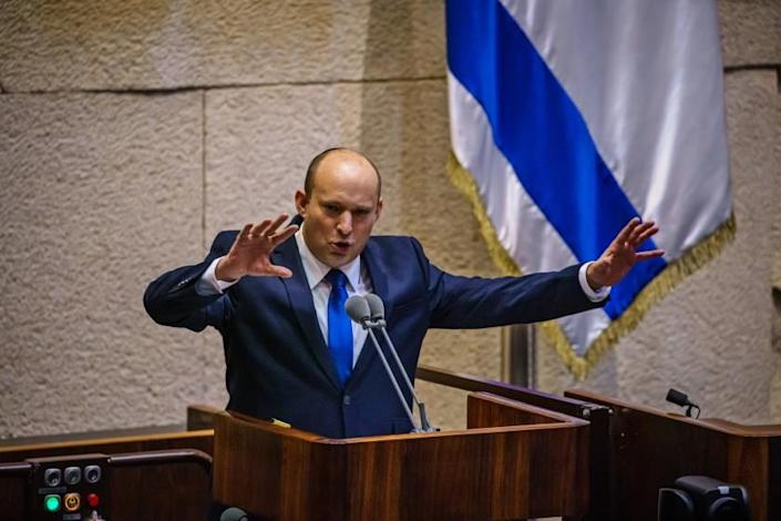 JERUSALEM, ISRAEL -- JUNE 13, 2021: Incoming Prime Minister Naftali Bennett addresses the Knesset, Israel's parliament, before the vote of confidence was cast confirming the new coalition government which unseated Benjamin Netanyahu as Prime Minister in Jerusalem, Israel, Sunday, June 13, 2021. (MARCUS YAM / LOS ANGELES TIMES)