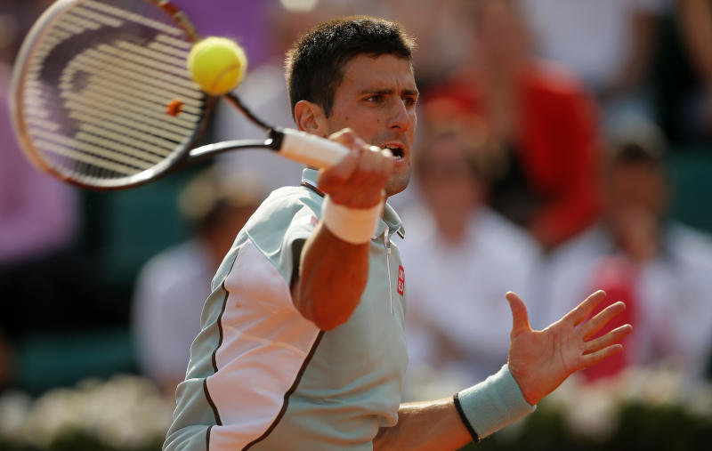 Serbia's Novak Djokovic returns the ball to Germany's Tommy Haas during their quarterfinal match of the French Open tennis tournament at the Roland Garros stadium Wednesday, June 5, 2013 in Paris. Djokovic won 6-3, 7-6, 7-5. (AP Photo/Michel Spingler)
