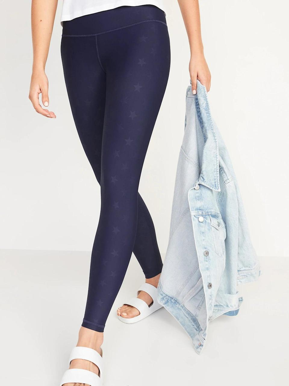<p>These beloved <span>Old Navy Extra High-Waisted Powersoft Hidden Pocket 7/8-Length Leggings</span> ($40) come in so many different colors, but we're into the navy stars.</p>