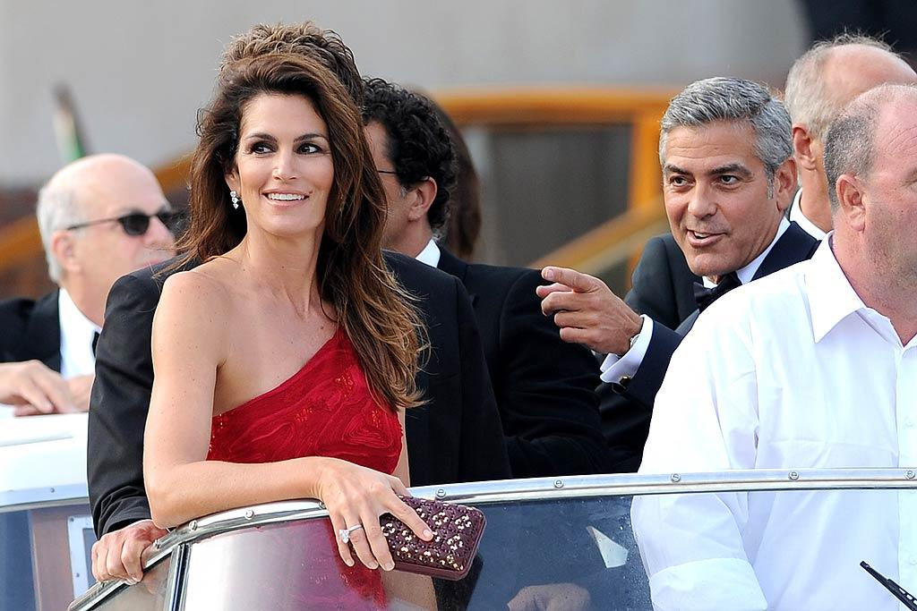 "Watch out Venice, here comes Clooney! The dashing actor attracted plenty of attention when he cruised into the 68th Venice Film Festival with a crowd including former supermodel Cindy Crawford and her husband, Rande Gerber. Jacopo Raule/<a href=""http://www.wireimage.com"" target=""new"">WireImage.com</a> - August 31, 2011"