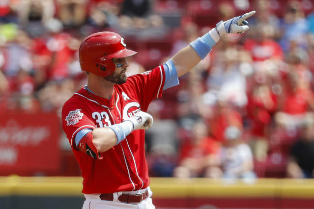 Cincinnati Reds' Jesse Winker reacts after hitting a two-run double off Texas Rangers starting pitcher Ariel Jurado in the second inning of a baseball game, Sunday, June 16, 2019, in Cincinnati. (AP Photo/John Minchillo)
