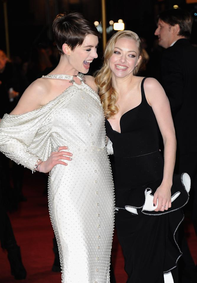 "LONDON, ENGLAND - DECEMBER 05:  Actresses Anne Hathaway and Amanda Seyfriend attend the ""Les Miserables"" World Premiere at the Odeon Leicester Square on December 5, 2012 in London, England.  (Photo by Stuart Wilson/Getty Images)"