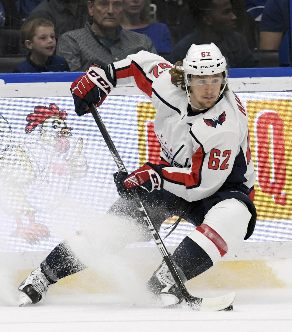 FILE - In this March 16, 2019, file photo, Washington Capitals left wing Carl Hagelin skates with the puck during the third period of an NHL hockey game against the Tampa Bay Lightning in Tampa, Fla. Hagelin is one of several players who couldve probably cashed out even richer contracts by going to free agency and opted instead to re-sign with their current teams. (AP Photo/Jason Behnken, File)