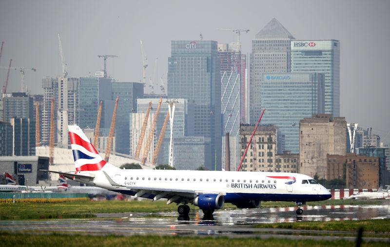 FILE PHOTO: A British Airways jet taxis at City Airport in London