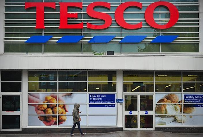 Tesco is suffering from fierce competition in Britain from supermarket price wars and German-owned discounters Aldi and Lidl (AFP Photo/Carl Court)
