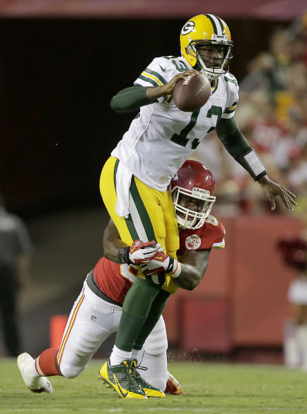 Green Bay Packers quarterback Vince Young (13) sacked by Kansas City Chiefs tackle Steven Baker (60) during the first half of a preseason NFL football game, Thursday, Aug. 29, 2013, in Kansas City, Mo. (AP Photo/Charlie Riedel)