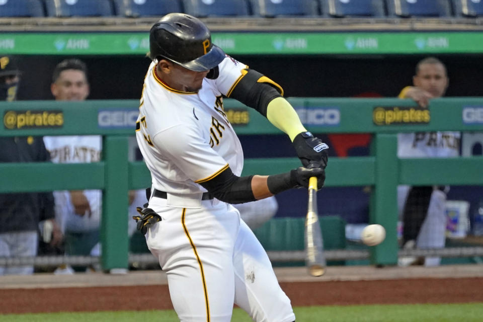 Pittsburgh Pirates' Erik Gonzalez singles off San Diego Padres starting pitcher Blake Snell, driving in a run, during the first inning of a baseball game in Pittsburgh, Tuesday, April 13, 2021. (AP Photo/Gene J. Puskar)