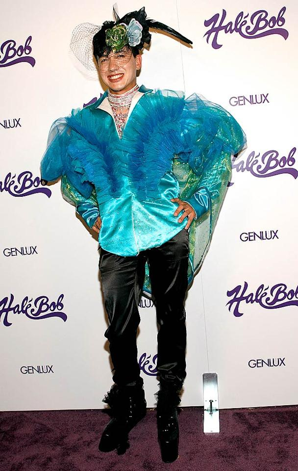 I suppose we shouldn't be surprised to see Bobby Trendy donning a scary ensemble consisting of a ruffled turquoise blouse and a vile veil. Michael Bezjian/ WireImage.com - July 9, 2008
