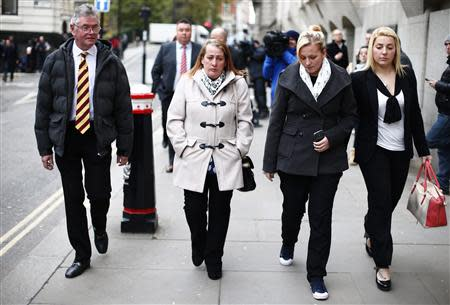 Family members of British soldier Drummer Lee Rigby leave during a lunch break in the trial of his suspected murderers at the Old Bailey in central London December 3, 2013. REUTERS/Andrew Winning