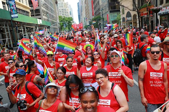 <p>Members of GMHC wave rainbow flags during the N.Y.C. Pride Parade in New York on June 25, 2017. (Photo: Gordon Donovan/Yahoo News) </p>