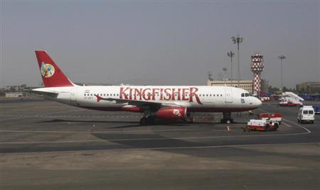 A Kingfisher Airlines aeroplane sits on the tarmac at Chhatrapathi Shivaji International Airport in Mumbai, March 9, 2012. REUTERS/Vivek Prakash/Files