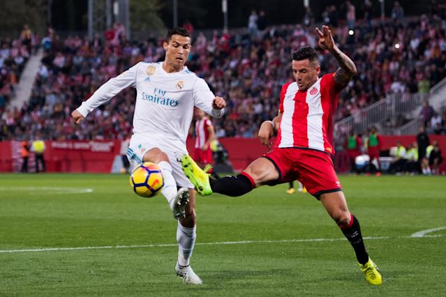 "<a class=""link rapid-noclick-resp"" href=""/soccer/players/cristiano-ronaldo/"" data-ylk=""slk:Cristiano Ronaldo"">Cristiano Ronaldo</a> and <a class=""link rapid-noclick-resp"" href=""/soccer/teams/real-madrid/"" data-ylk=""slk:Real Madrid"">Real Madrid</a> were outplayed and beaten by Girona. (Getty)"