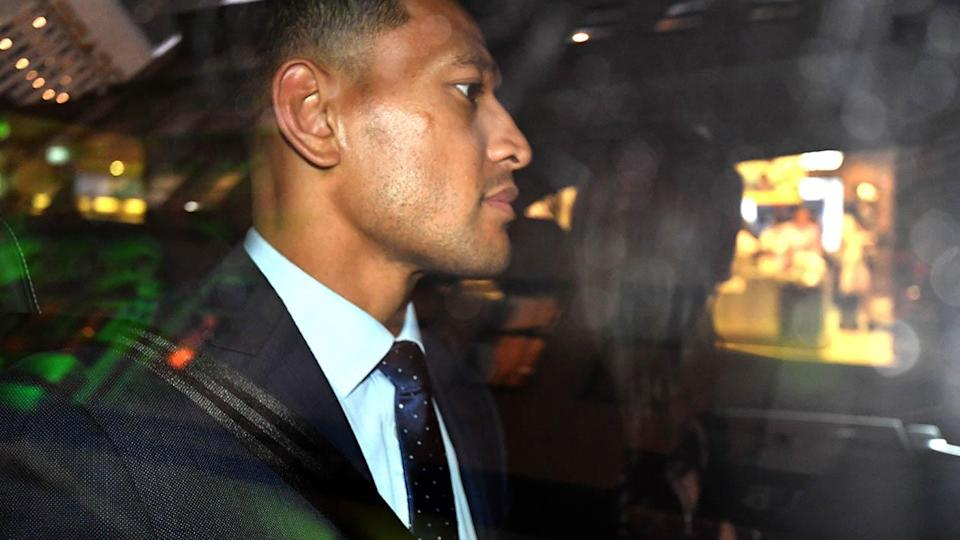 Israel Folau leaves his code of conduct hearing. (Photo by SAEED KHAN/AFP/Getty Images)