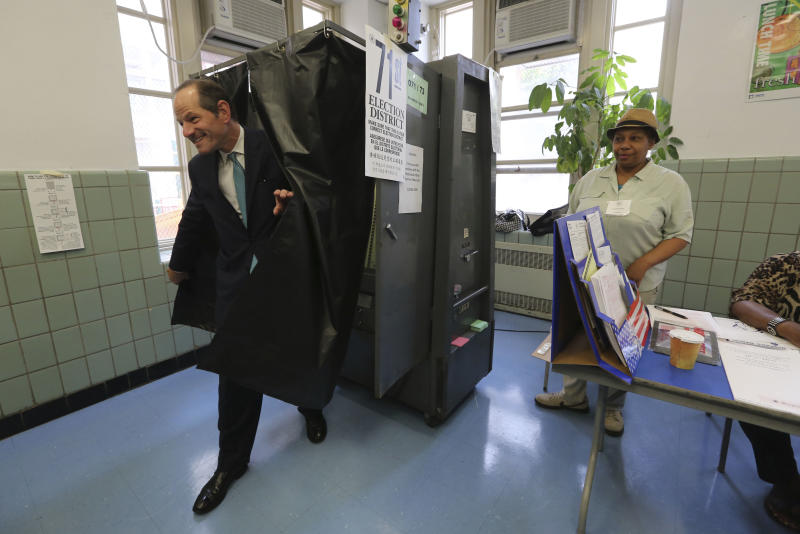 Democratic comptroller hopeful Eliot Spitzer exits the voting booth after casting his vote in the primary election at his polling station in New York, Tuesday, Sept. 10, 2013. (AP Photo/Mary Altaffer)